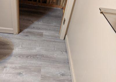 New vinyl floor goes from bathroom into hallway