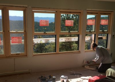 Builder muds new drywall tape below 6 new windows