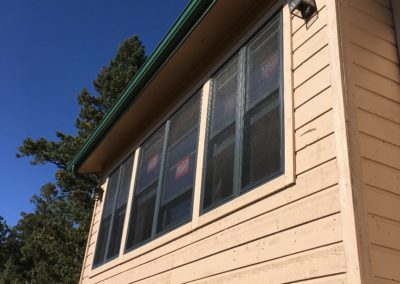 Outside view of 6 new windows and siding