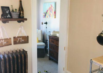 Empty doorway between kitchen and bedroom with door slab and hinges removed