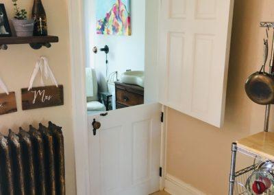 Dutch door with top half open and bottom half latched