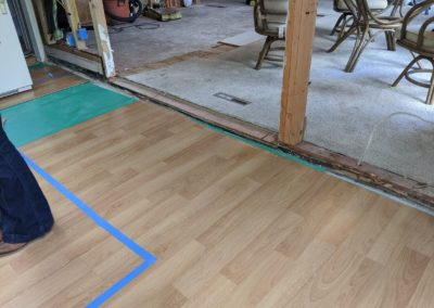 Vinyl flooring is lower than the floor height of the carpeted room