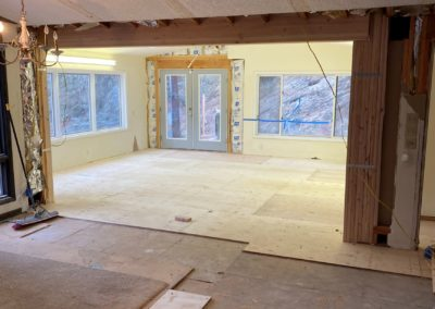 View into room with new plywood subfloor and French door raised to same height