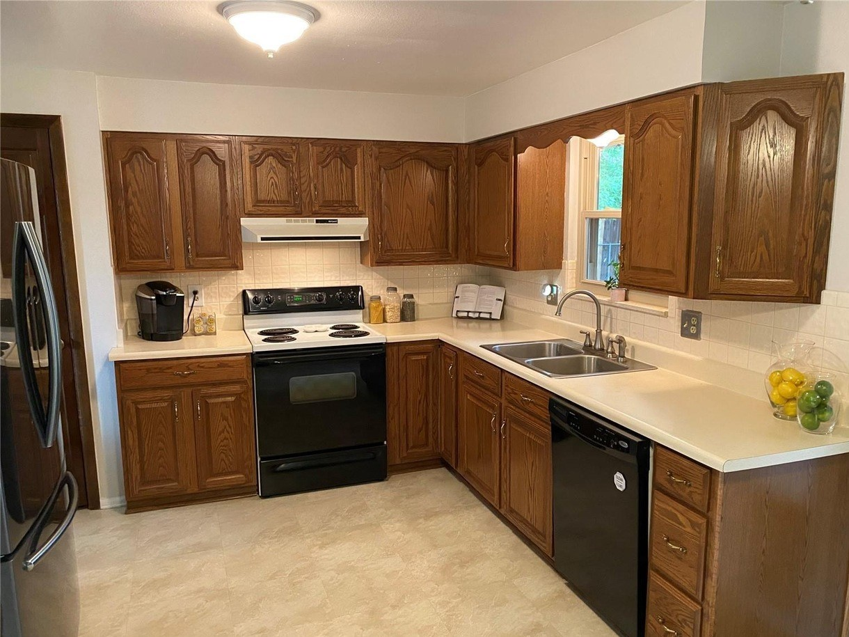 We'll reuse almost all of these cabinets in our new kitchen floor plan, but the doors and drawer faces will be updated with paint.