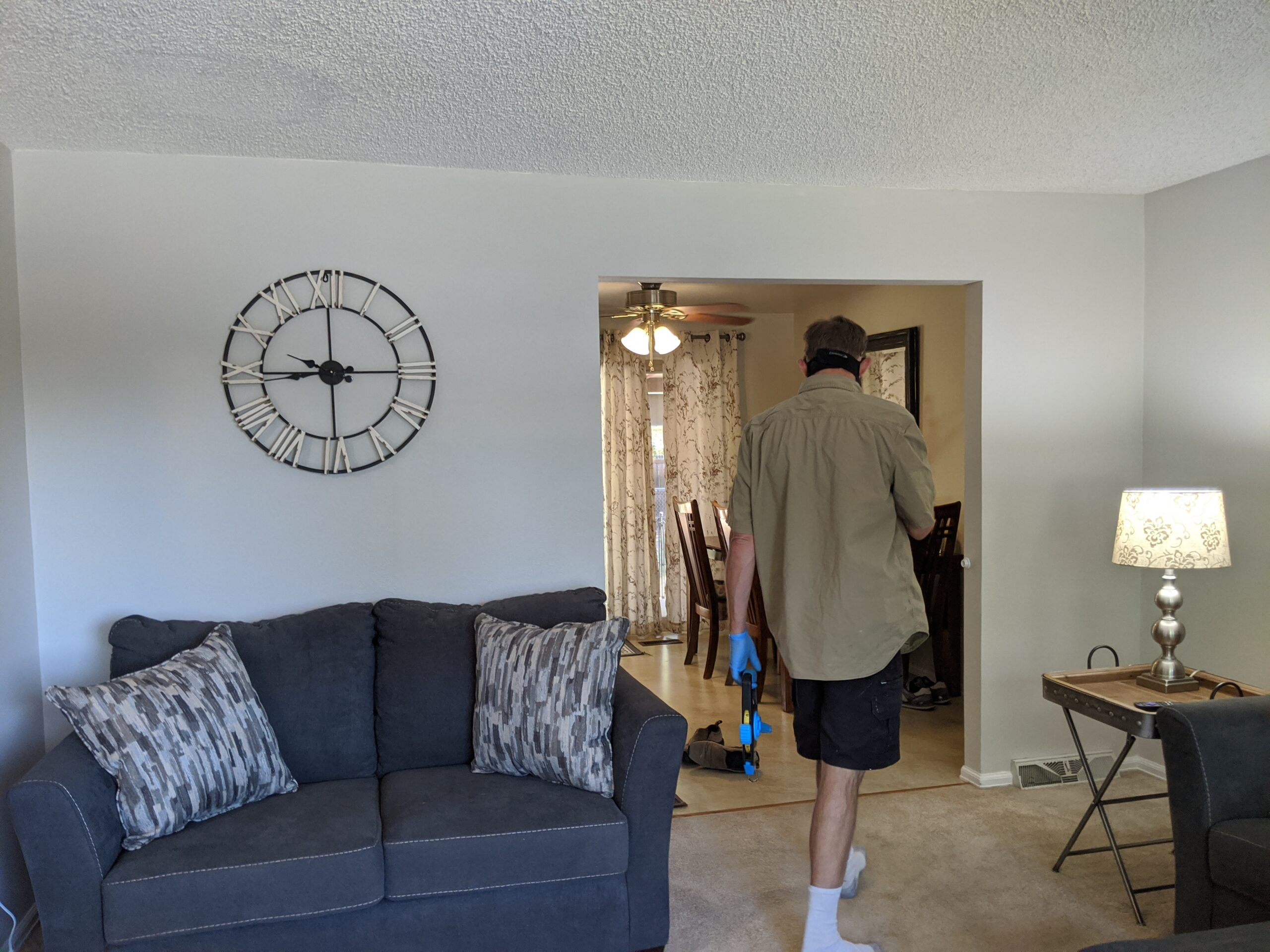 Living spaces in older homes were typically broken up into smaller rooms, but modern living favors open floor plans. This non-loading bearing wall that separates the living room and kitchen also blocks natural light flowing through the house. It's coming down!