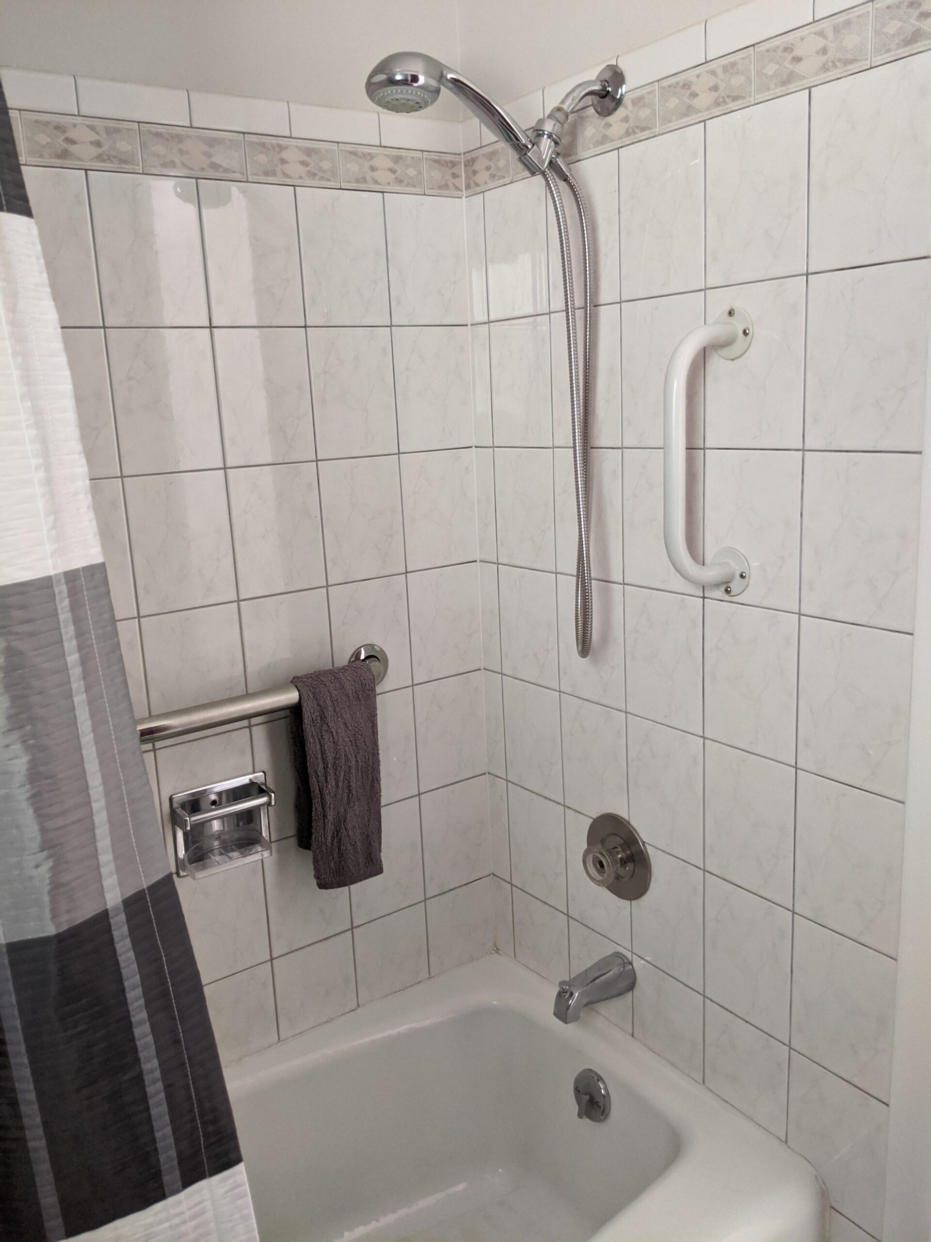 In order to add a second bathroom on the main level, we're going to change the floor plan of the existing bathroom, including rotating this shower 90-degrees. Luckily, the tub can be reused without refinishing the surface.
