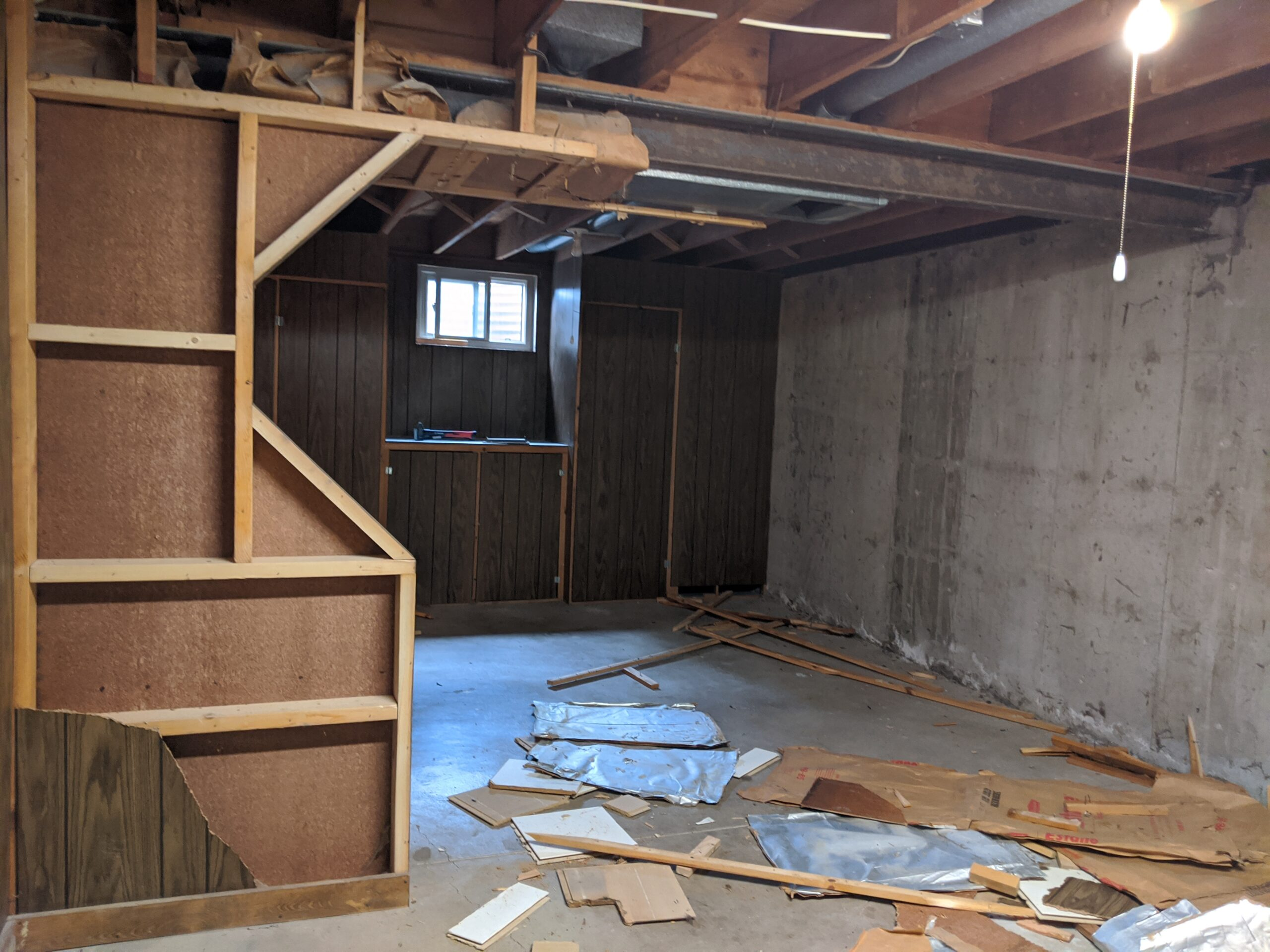 We could hardly wait to take down the ugly paneling! This is the first picture that Mim got, after Josh had already removed 3 sides of the archway and 1 whole wall of paneling.