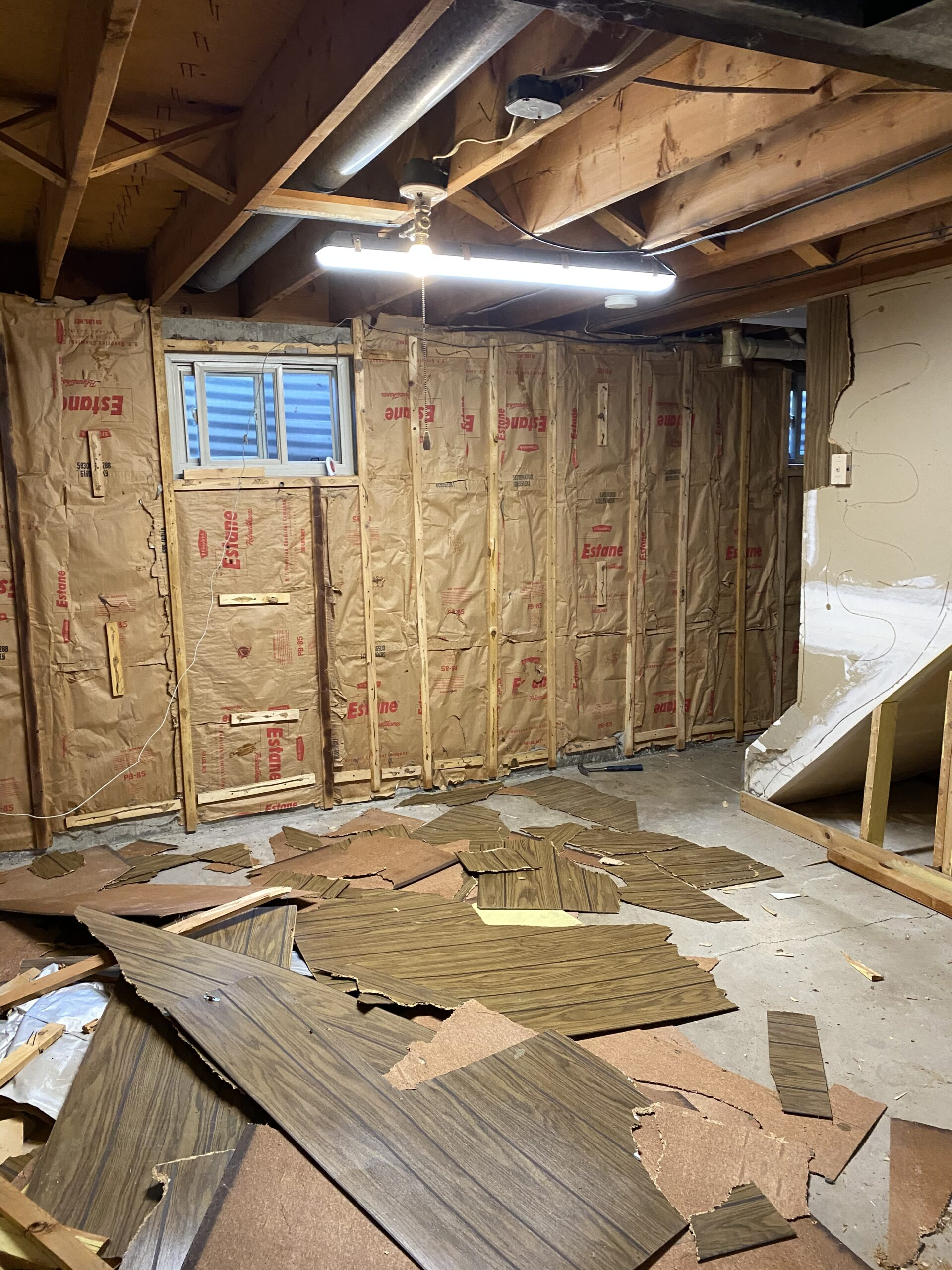 All the paneling has been pulled off the walls and side of the stairs.