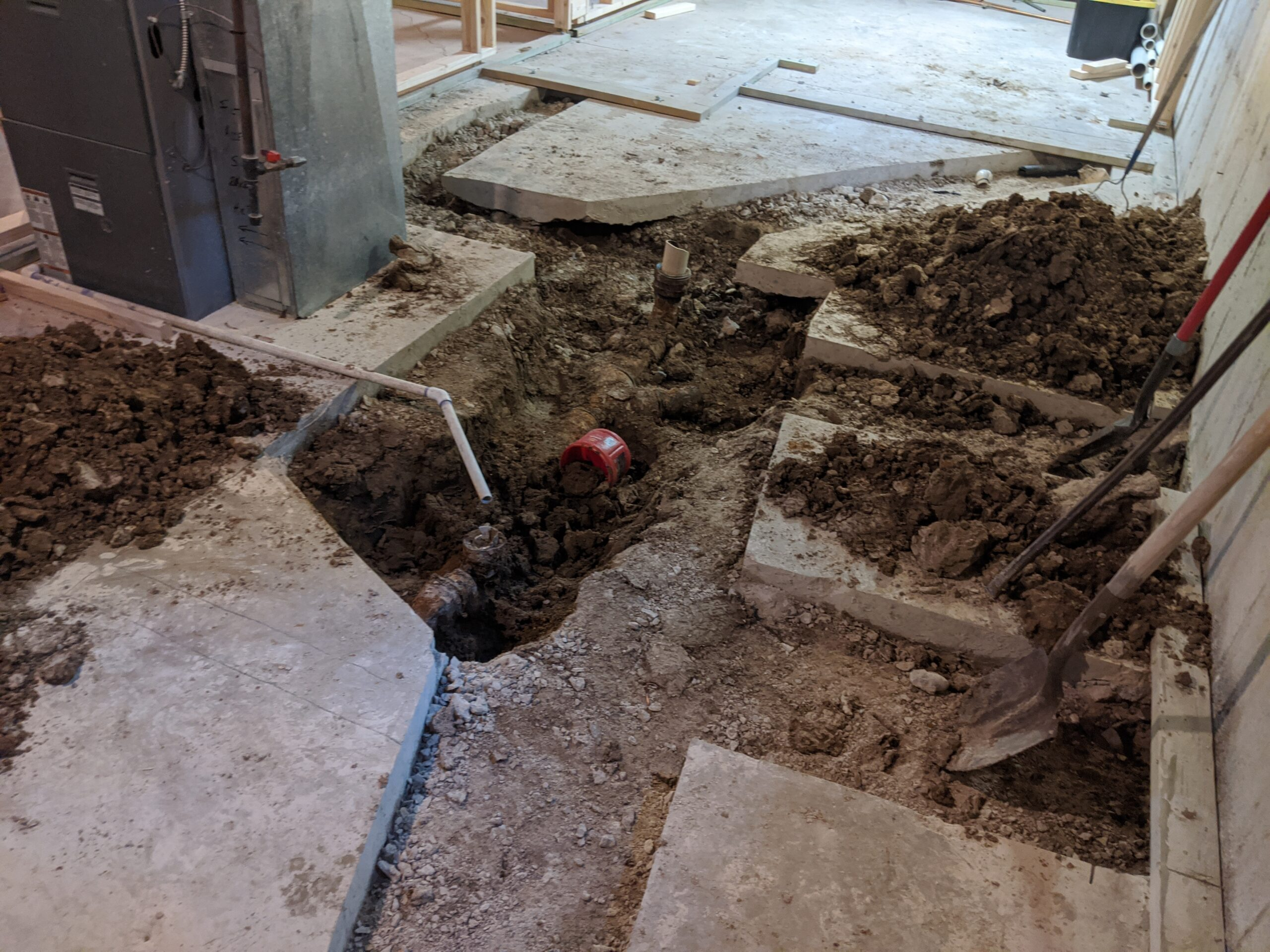We cut and dug up this much of the basement floor, including a new spot to drain the furnace condensation. Licensed plumber, Jake Jacoby of Progressive Mechanical, had to remove even more concrete to connect the new pipes to the main sewer line for our house.