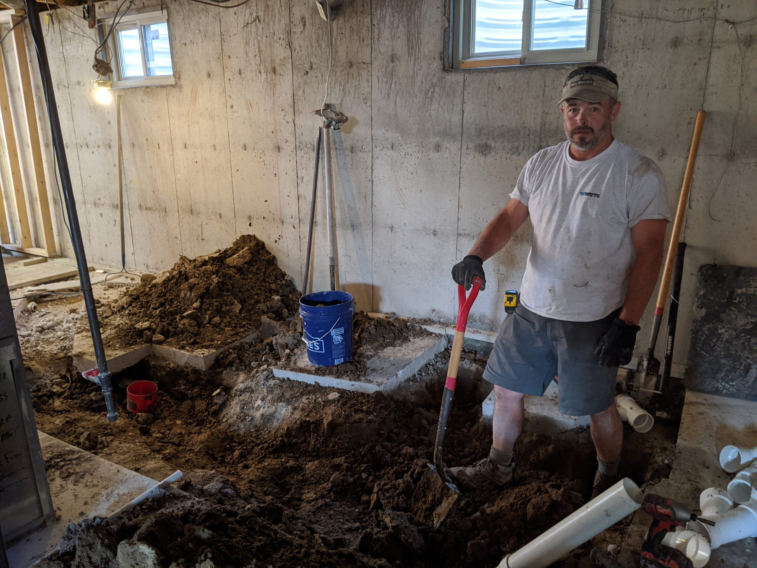 Our trusted licensed plumber, Jake Jacoby owner of Progressive Mechanical, shows how dirty and difficult it is to cut the concrete basement floor and dig up the soil beneath it to install new pipes for the bathroom/laundry room.