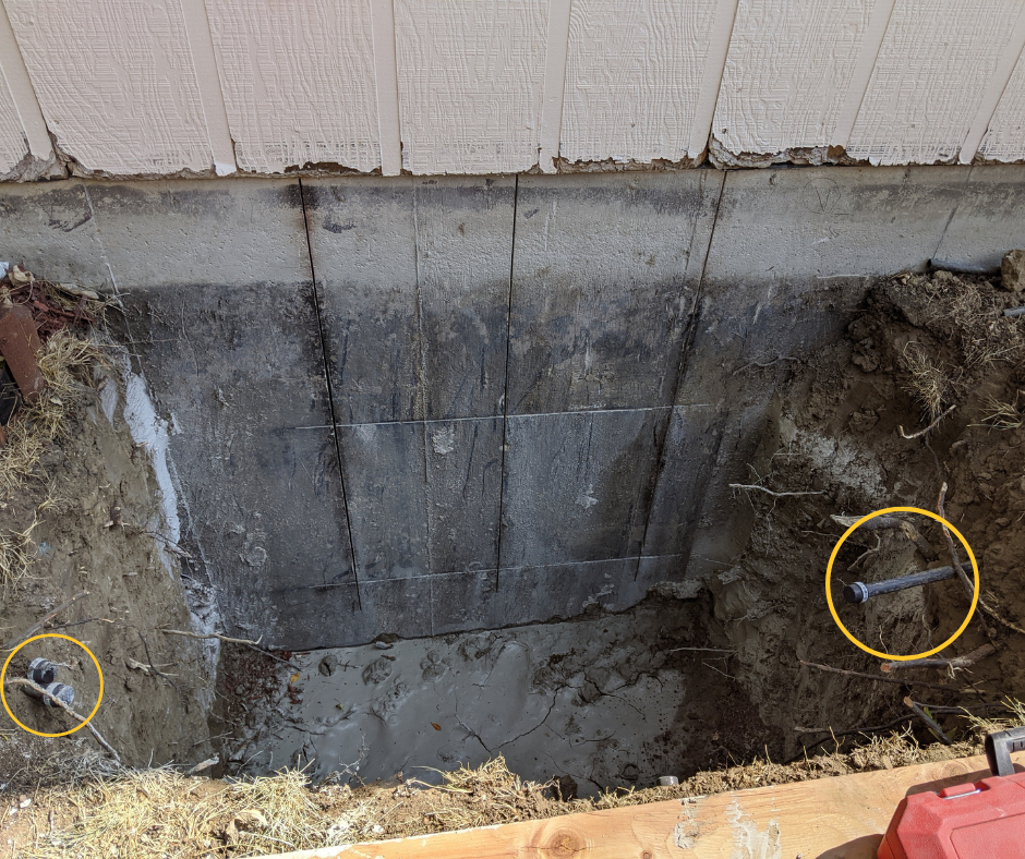 IN PROGRESS: Be sure to call before you dig! For safety's sake, you must make sure not to cut any power, water, gas, or other utility lines when digging deeper window wells. You also may have to cut, cap, and relocate underground sprinkler pipes, like those circled in yellow in this picture.