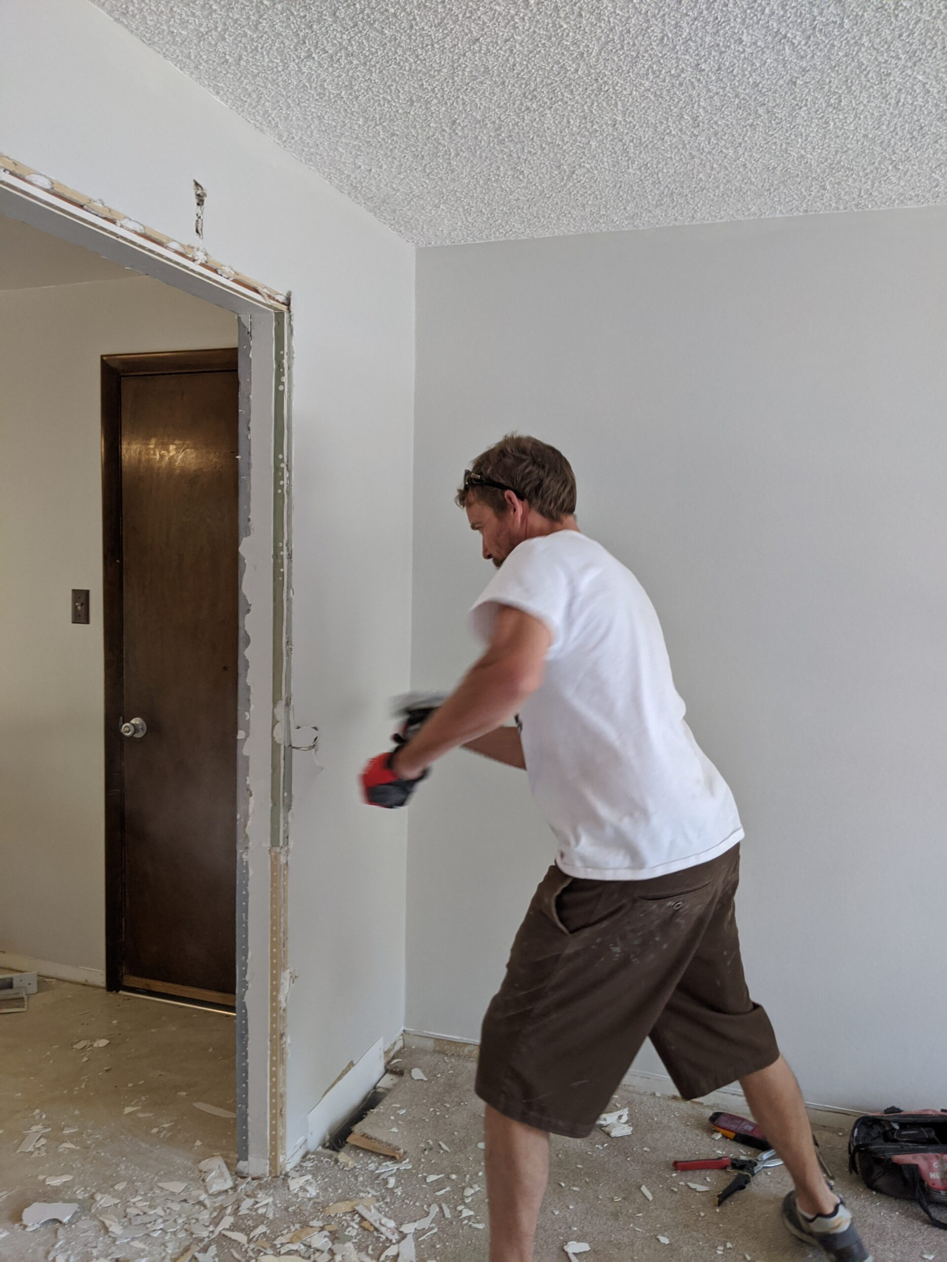 IN PROGRESS Josh demolished the drywall with a sledgehammer to reveal the framing in the wall.