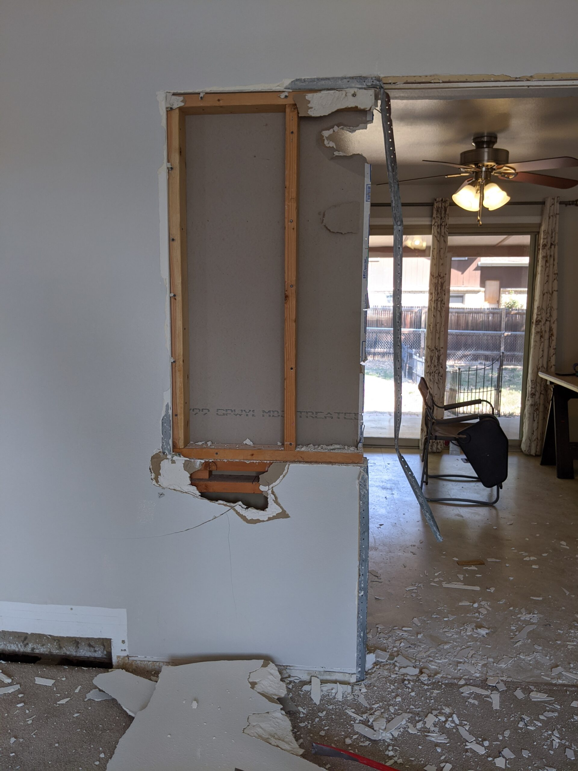 IN PROGRESS Once we removed sections of drywall, we discovered that the wall between the kitchen and living room had also been pony walls (not full height) at some point in our home's past.
