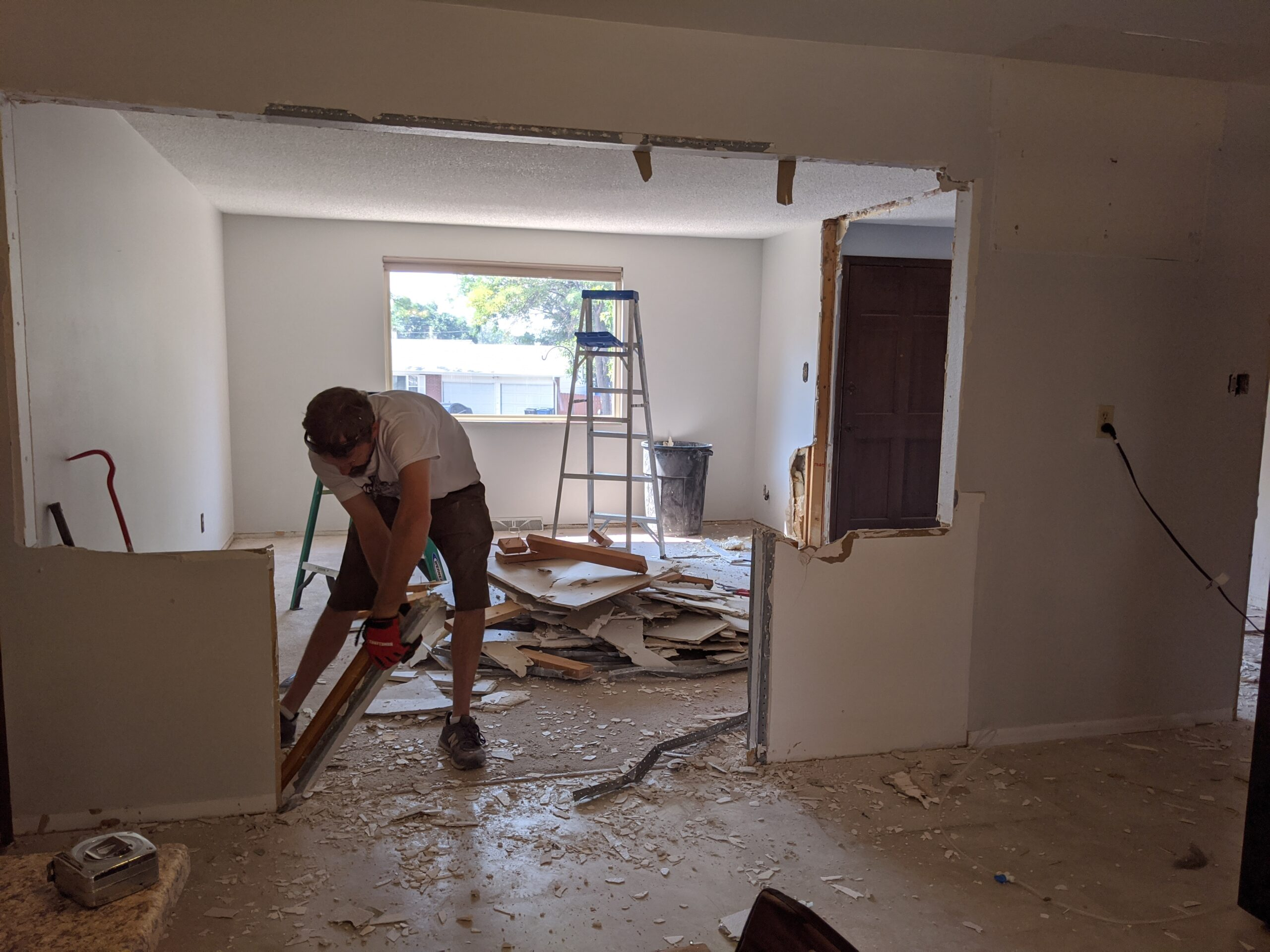 IN PROGRESS Josh cut the framing above the pony walls. Then, he continued to knock down the old wall.