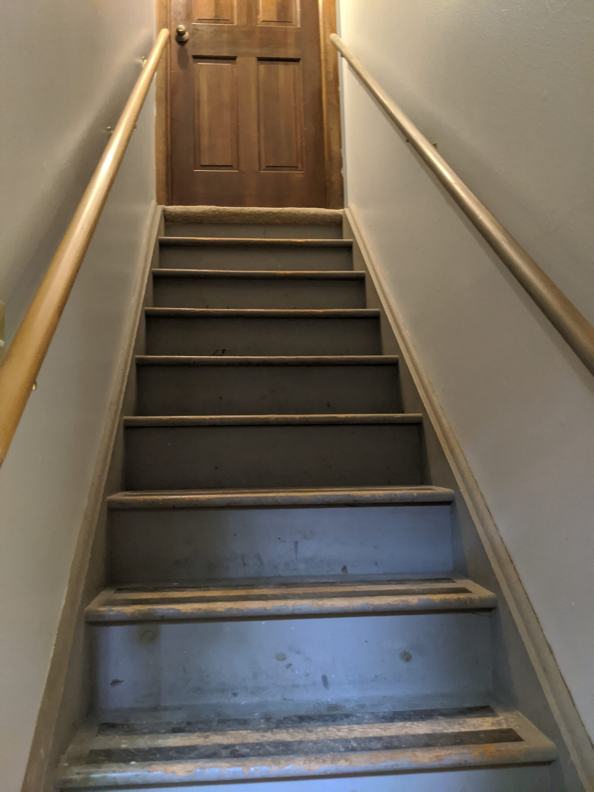 BEFORE: These stairs in the middle of the hallway blocked the potential for better use of the space on both floors.