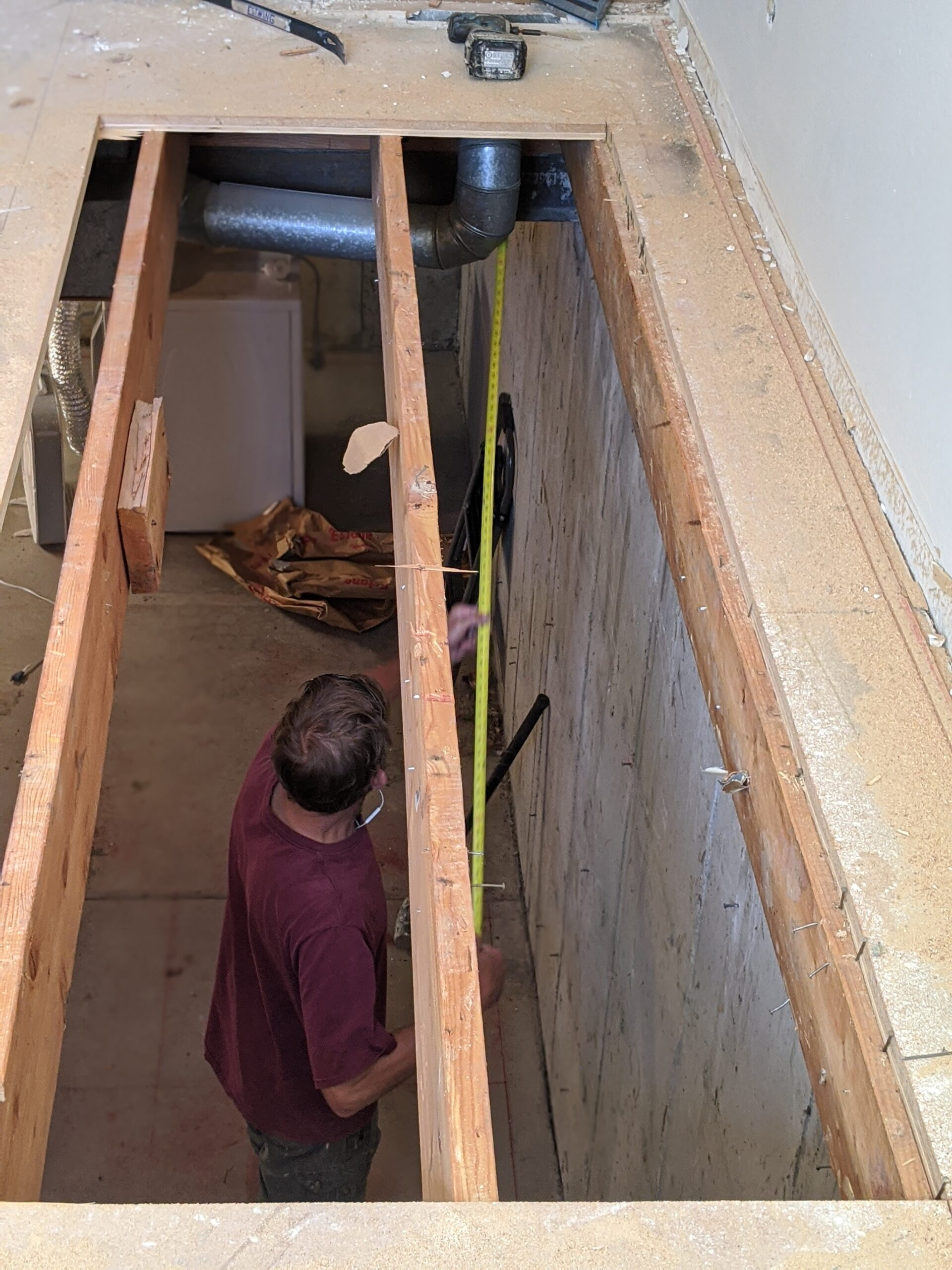 IN PROGRESS: Looking into the basement as Josh takes more measurements before cutting the original floor joists