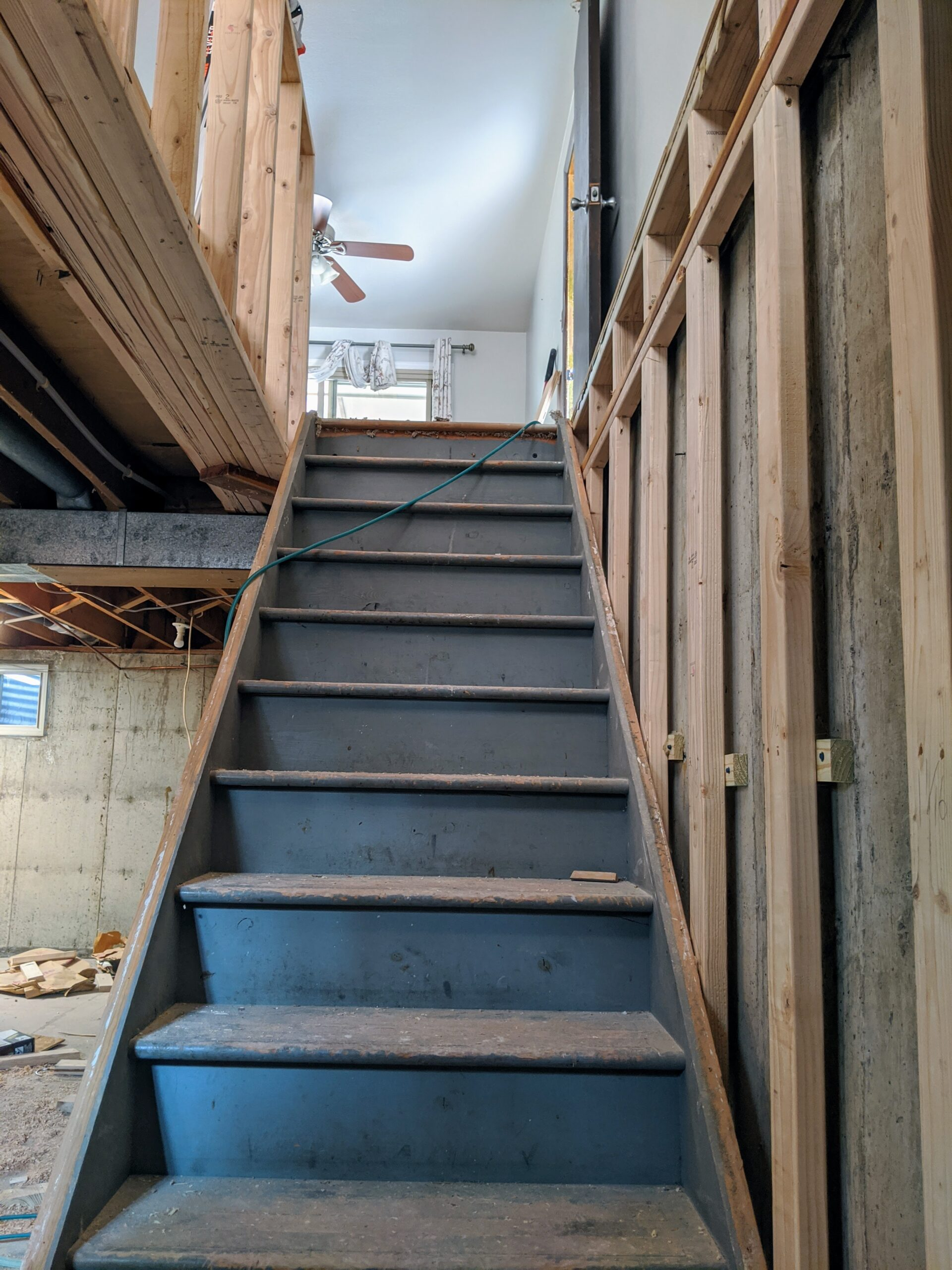 We reused the original stairs in a new location to maximize the approximately 2,200 square feet of space in our new home.