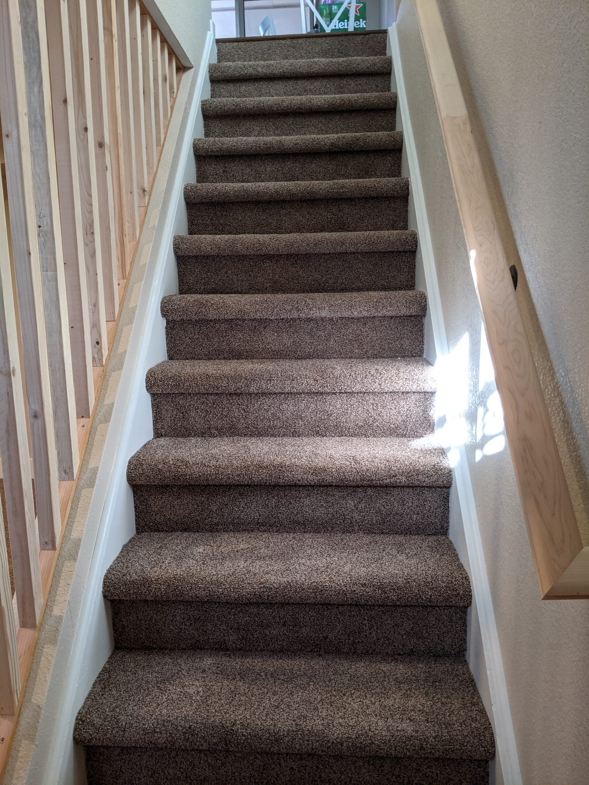 AFTER: The finished stairway with handrail, guardrail, carpeting, drywall, trim, & paint
