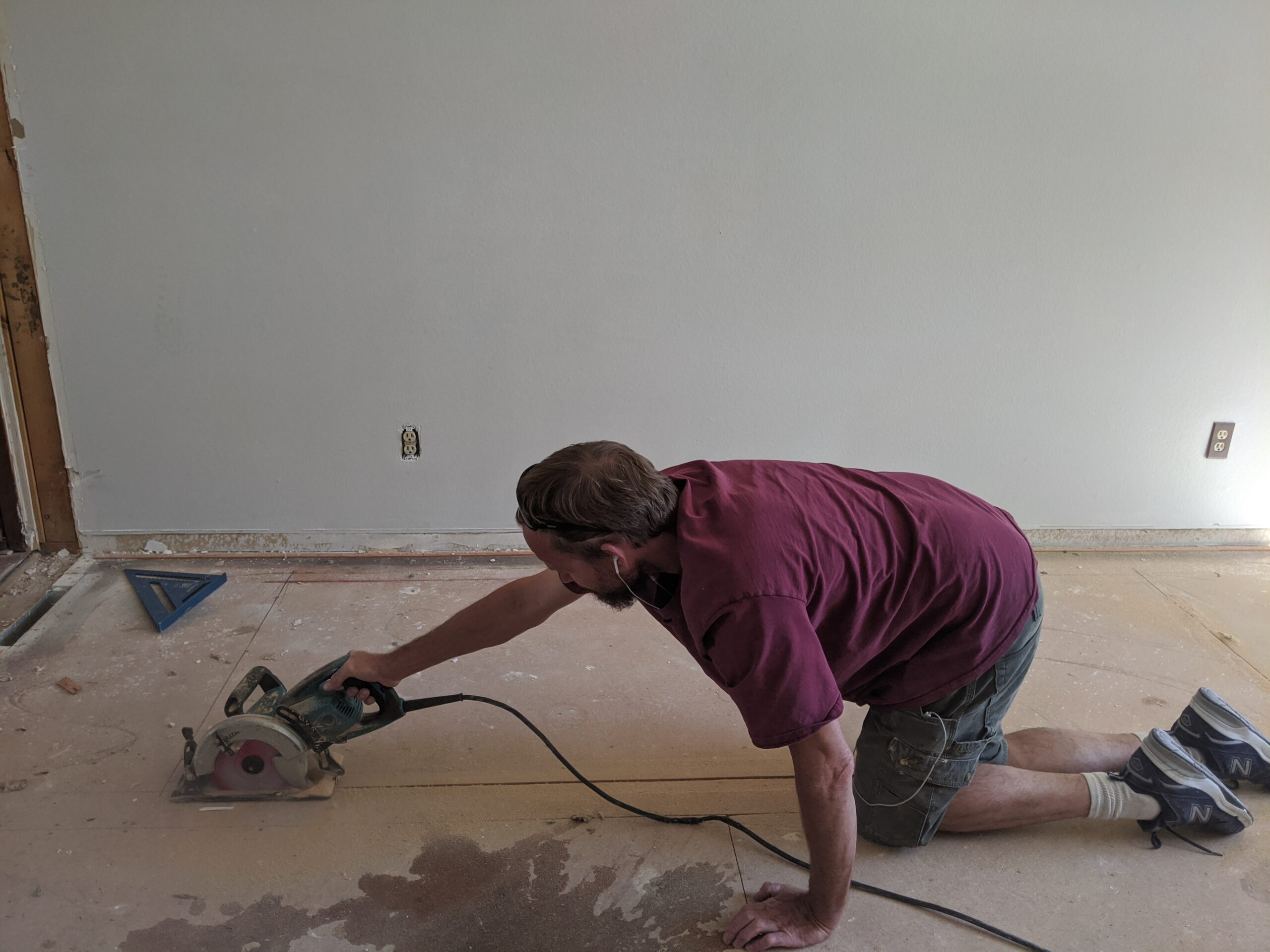 IN PROGRESS: Josh cut out the subfloor to make the new stairway opening.