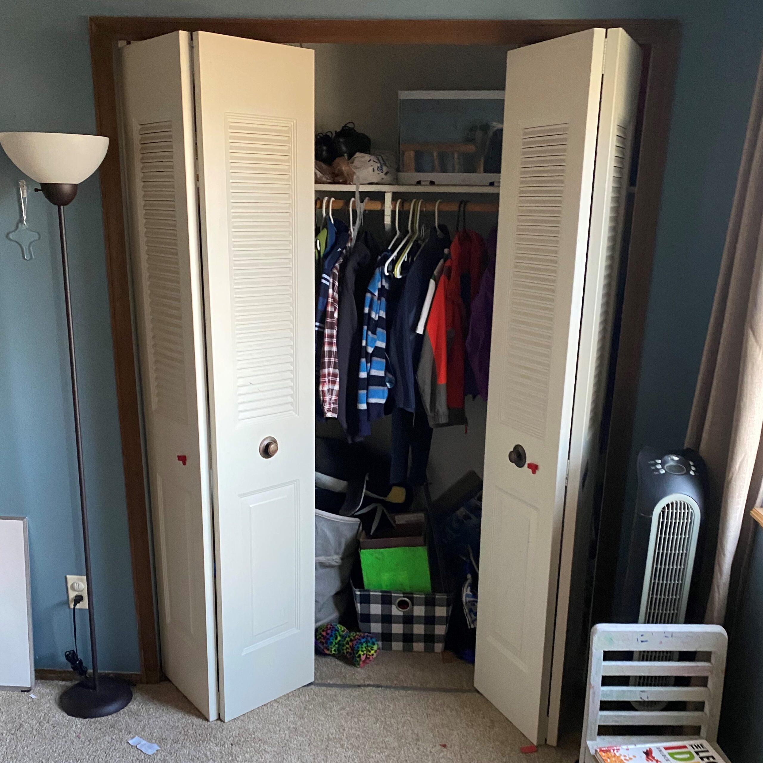 Metal bi-fold closet doors with louvers in the top half