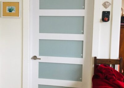 Door with 5 rectangular, frosted glass panels