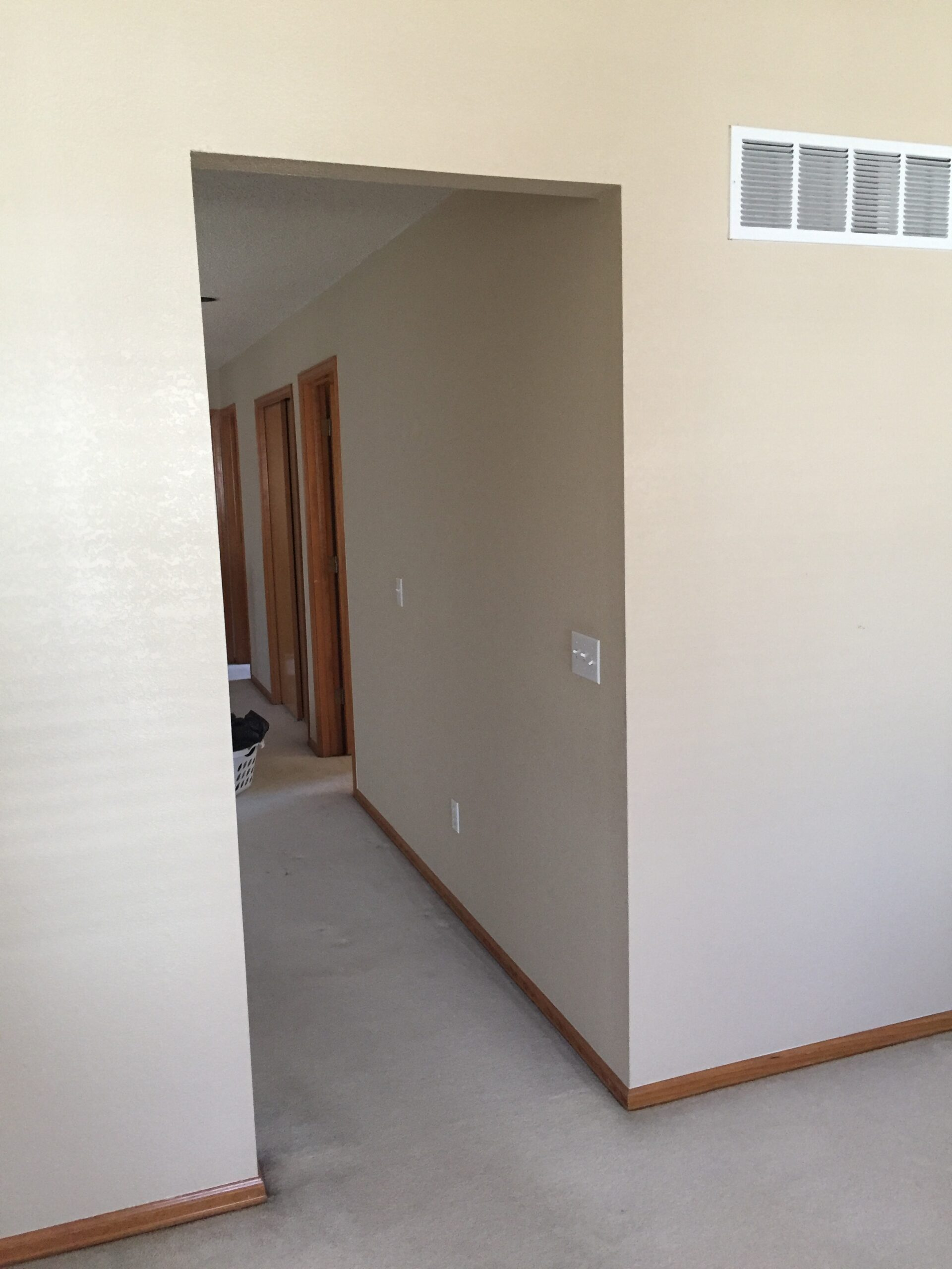 Tall walkway in hall without door