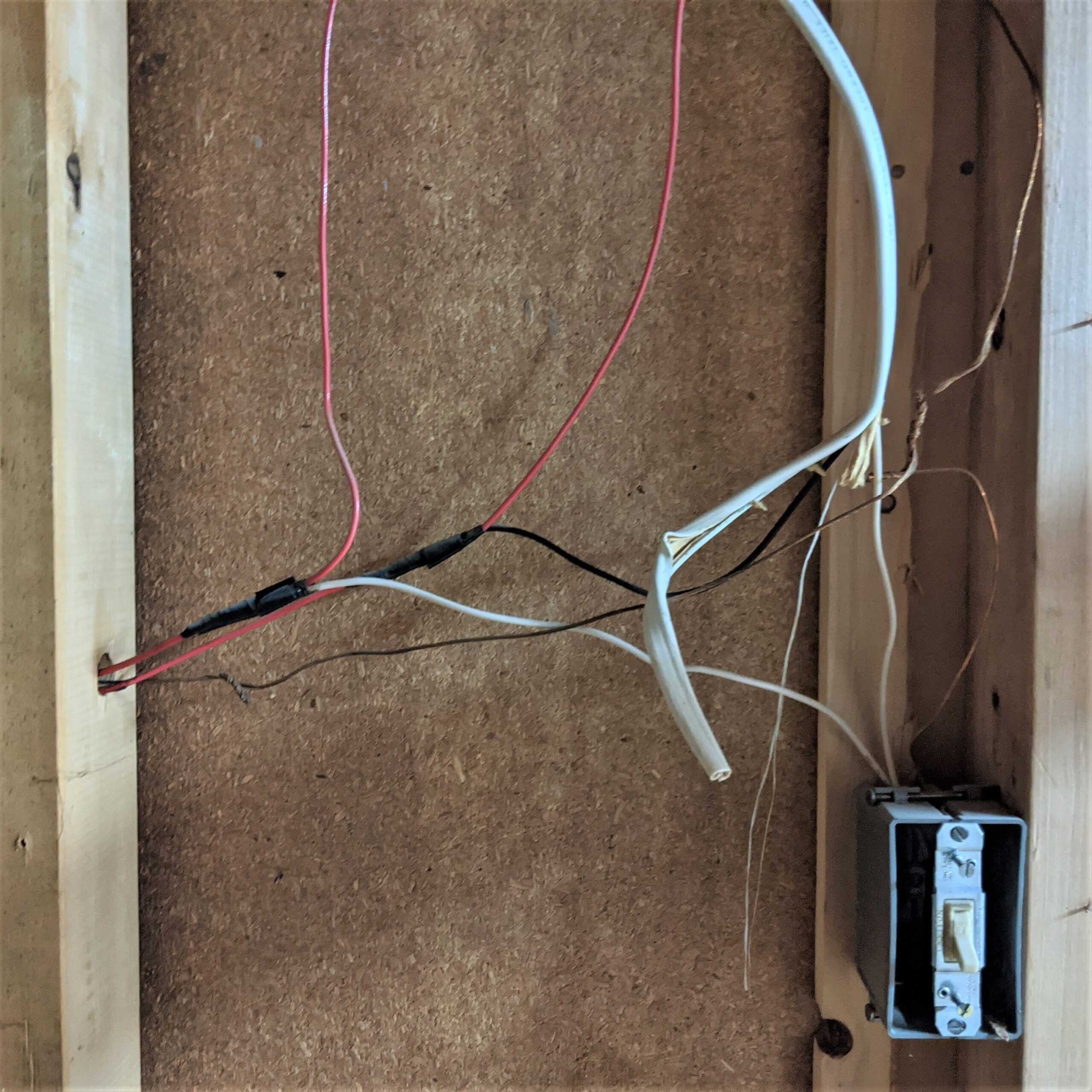 This frightful DIY wiring was hidden by the wooden paneling in the basement of our first home. Luckily, we planned to finish the basement and hire a state-licensed electrician to install all new wiring per electrical safety codes.