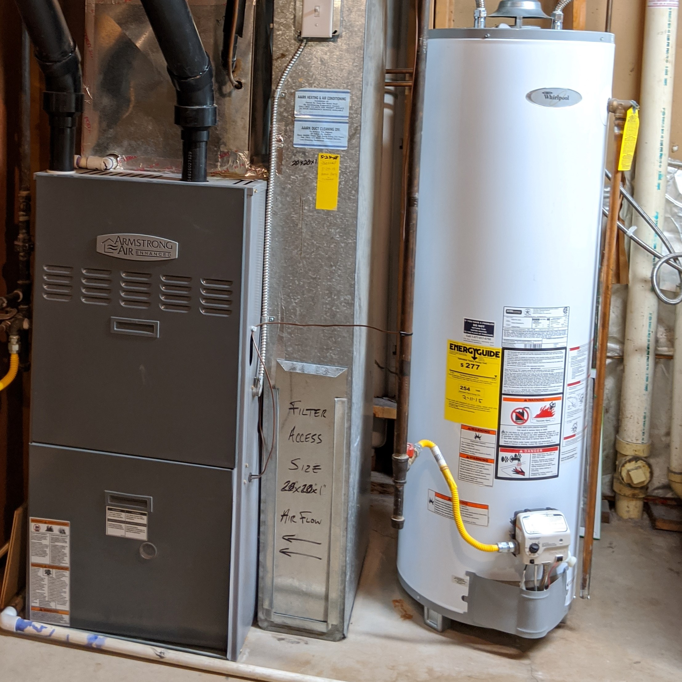 The yellow stickers on the furnace duct (center) and water heater (right) showed the maintenance and purchase dates. The sellers also gave us the original receipts and manuals, so we didn't need to research them.