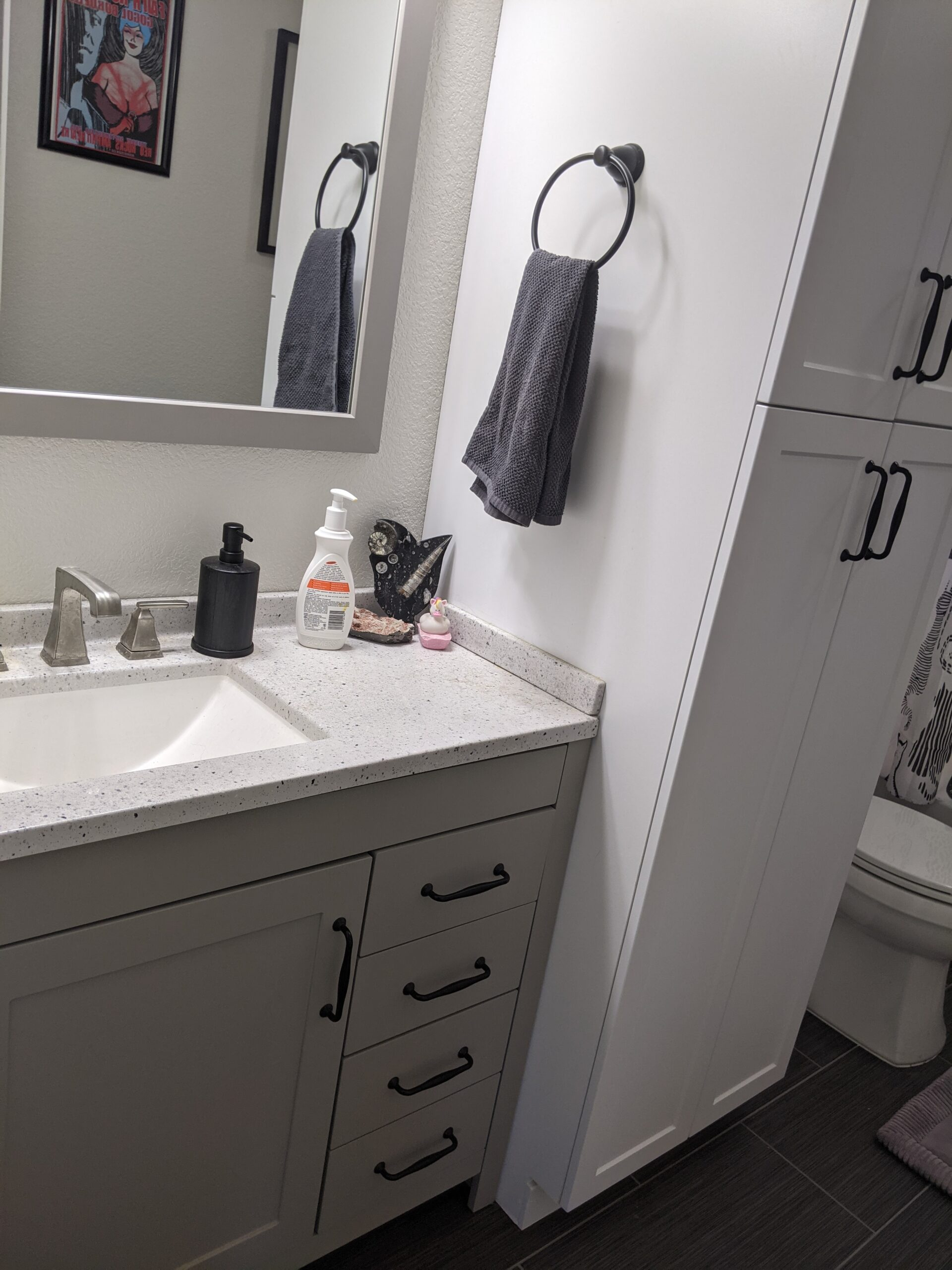 We bought new handles and drawer pulls so the vanity and linen cabinet matched. Don't forget that bathrooms need toilet paper holders and towel rods, too.