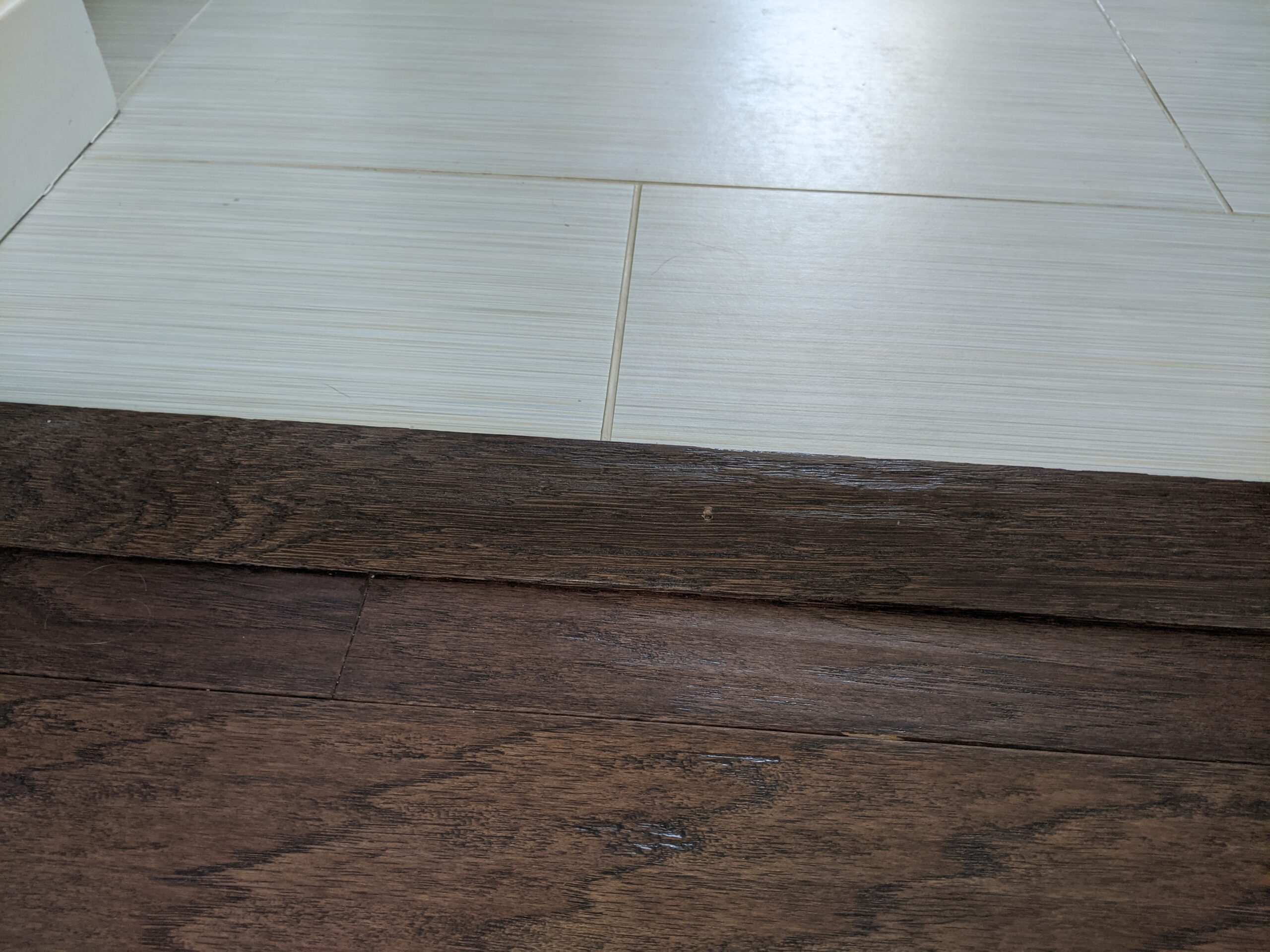 We needed transition pieces for wherever the wood floor touched the tiles, but saved time and money by buying in-stock pieces with a matching wood tone, rather than ordering it from the specific floor manufacturer.