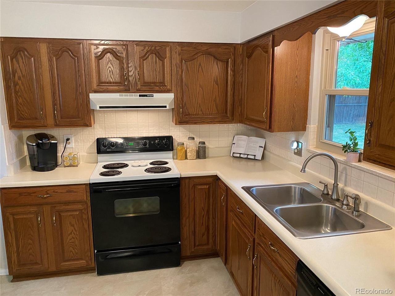 BEFORE The oak cabinets made this kitchen look very dated.