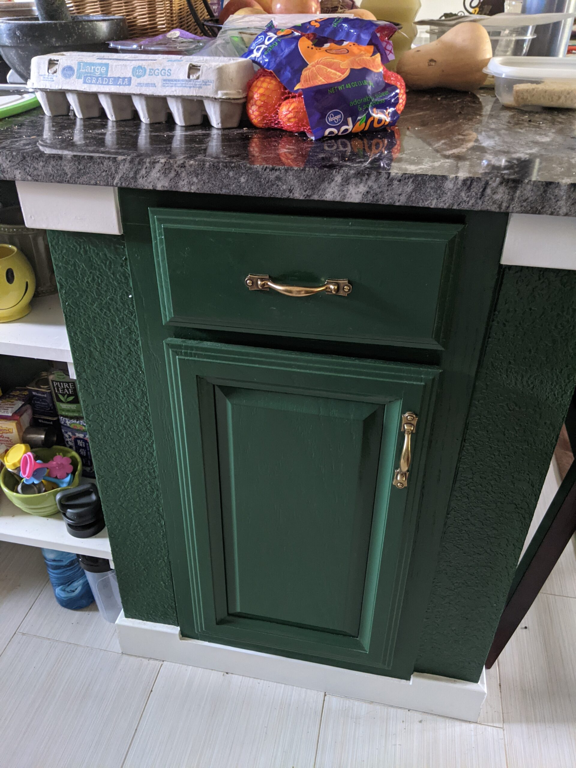 AFTER We reused the cabinets in the new kitchen layout, but we updated the look with the lower cabinets painted green and uppers painted white.