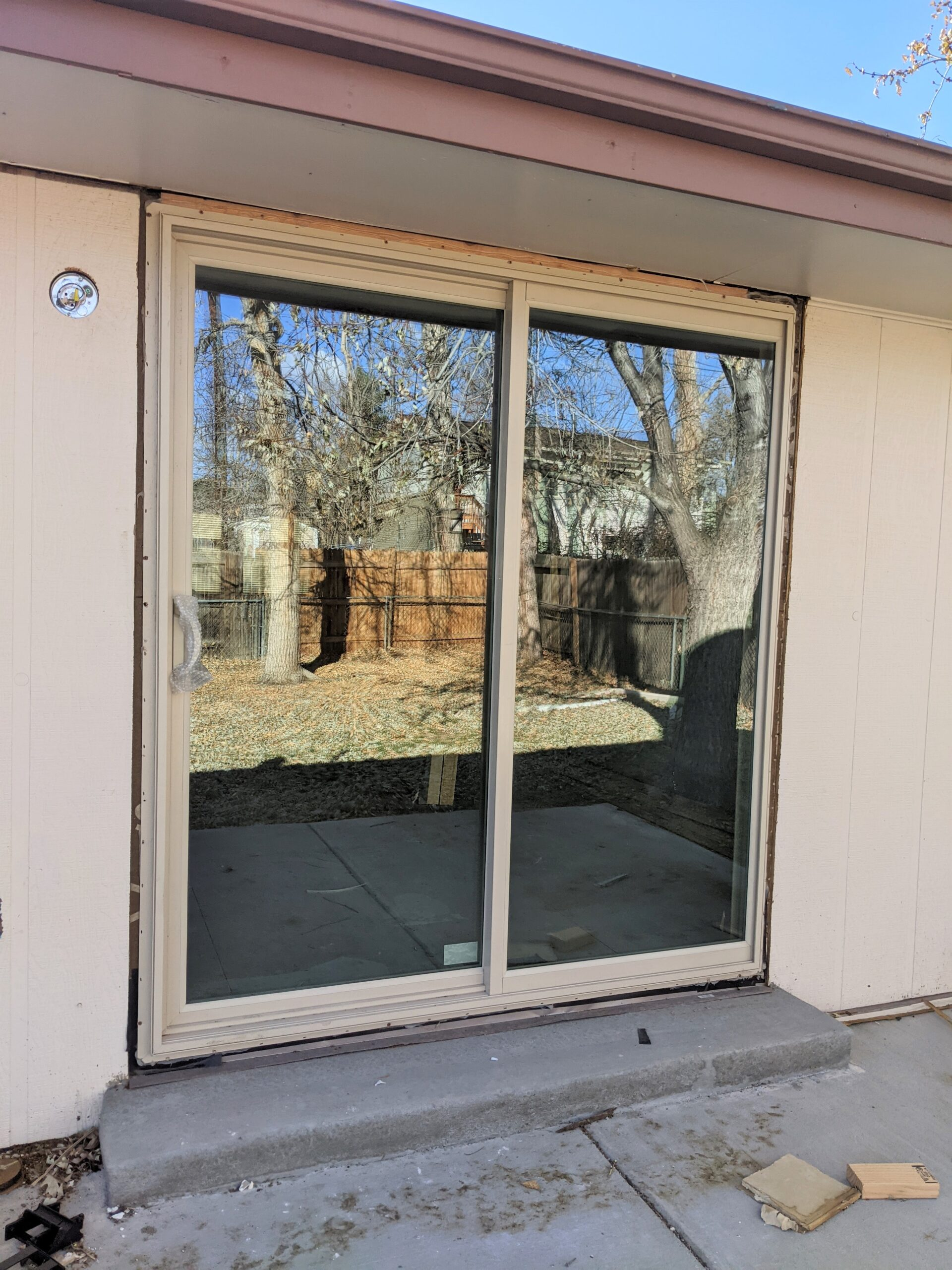 AFTER We add insulation in the gap between the door frame and wall as part of the installation of exterior doors.