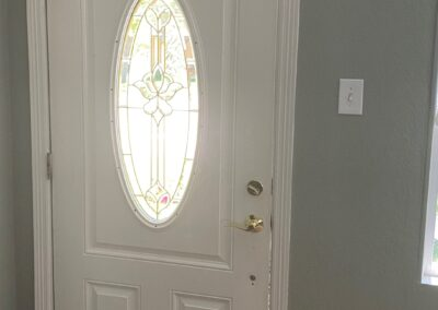 BEFORE Light through the gaps on the right side of this door highlights where weather and pests can get in.