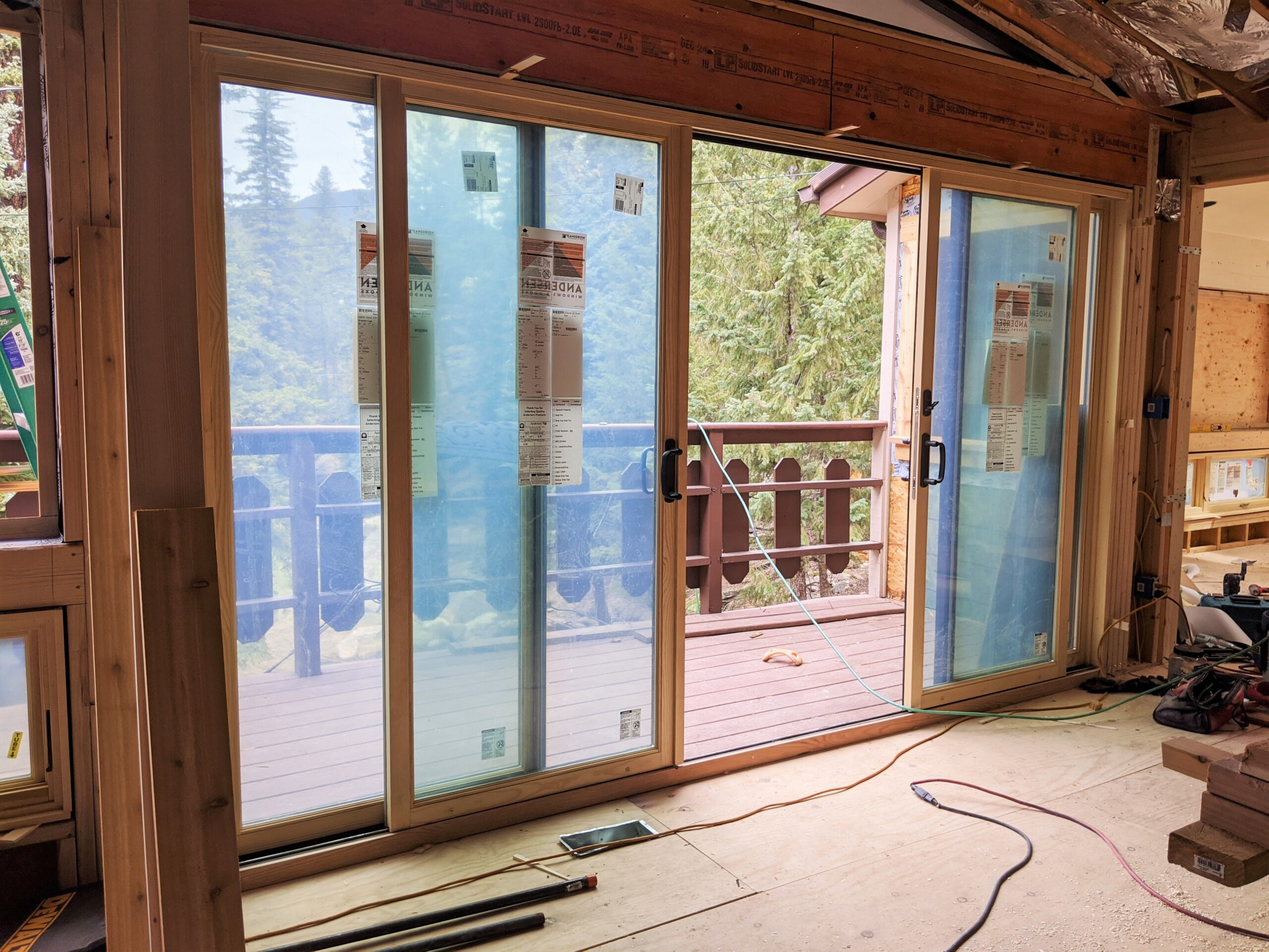 AFTER We installed this 4-paneled sliding glass door, which maximizes the views in this mountain home.