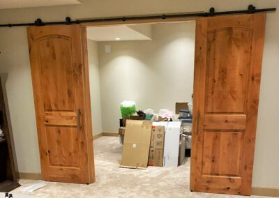 AFTER These oversized, double barn doors add style while separating these 2 rooms.