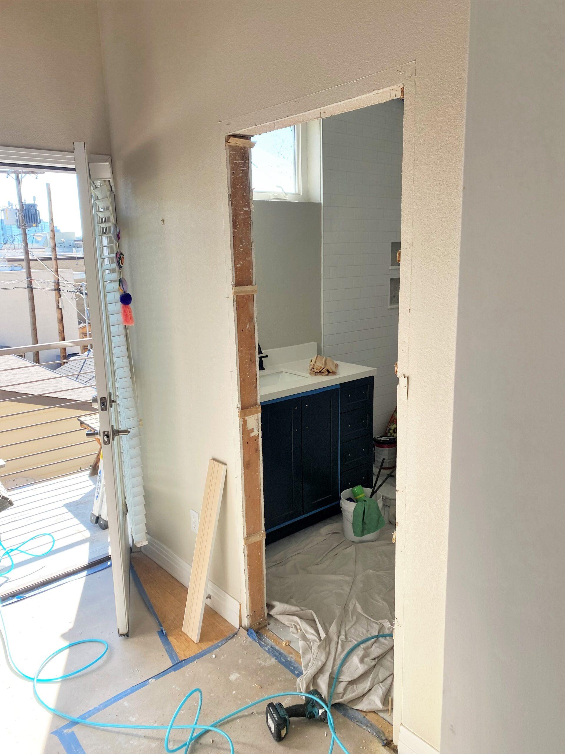 BEFORE Josh trimmed out 2 doorways in this bathroom before installing barn doors in each.